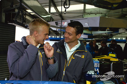 Heikki Kovalainen and Fabio Carbone visit Renault F1 garage area