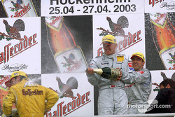 The podium: champagne for race winner Bernd Schneider, Marcel Fassler and Laurent Aiello