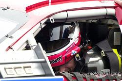 Kyle Petty puts on his helmet