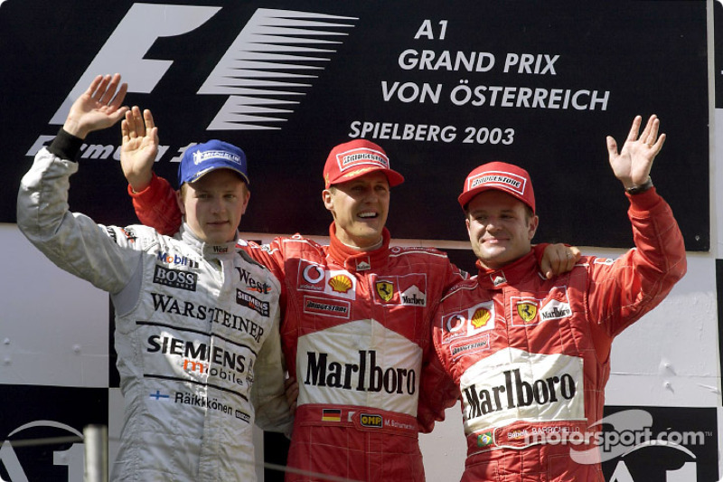 The podium: race winner Michael Schumacher with Kimi Raikkonen and Rubens Barrichello