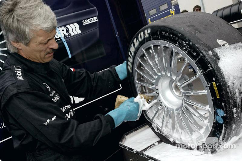 Crew member prepares the tires