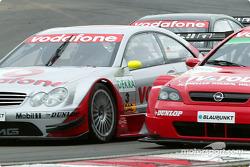 First lap: Bernd Schneider and Peter Dumbreck