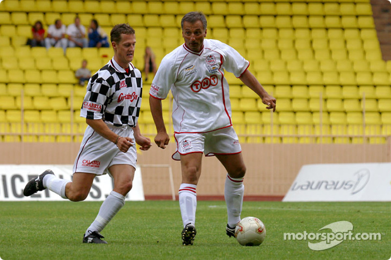 Football match at Stade Louis II in Monaco: Michael Schumacher and Riccardo Patrese