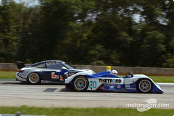 The #20 Dyson Racing Lola-MG passes the #43 Orbit Racing PorschePorsche