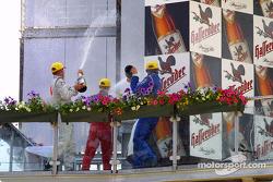 The podium: champagne for Bernd Schneider, Peter Dumbreck and Mattias Ekström