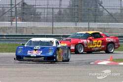 #50 Michael Baughman Racing Firebird makes room for race leader #58 Brumos Racing's Porsche Fabcar