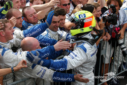 Race winner Ralf Schumacher celebrates