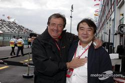 Giancarlo Minardi and a Bridgestone team member