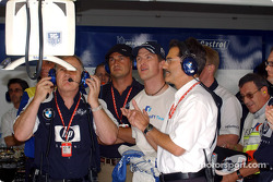 Patrick Head, Ralf Schumacher and Mario Theissen watch Juan Pablo Montoya's qualifying lap
