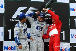The podium: champagne for race winner Ralf Schumacher, Juan Pablo Montoya and Michael Schumacher