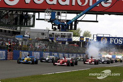 The start: Jarno Trulli and Rubens Barrichello lead the field