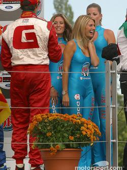 Podium: Michel Jourdain Jr. offers champagne to the Molson Dry girls