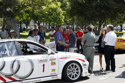 Fans and drivers socialize while cars are unloaded