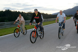 Karl Wendlinger rides a bike the A1-Ring with journalists
