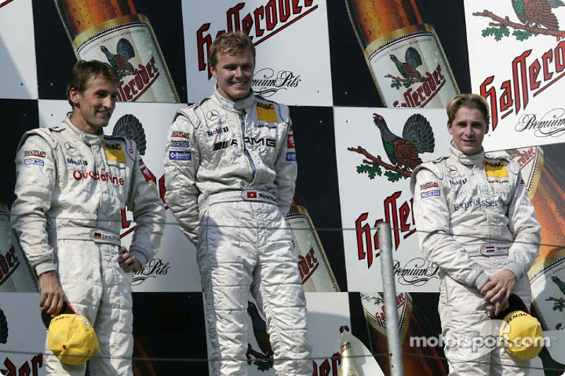 Podium: race winner Marcel Fassler with Bernd Schneider and Christijan Albers