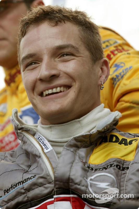 Timo Scheider celebrates pole position