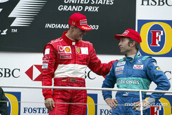 Podium: race winner Michael Schumacher with Heinz-Harald Frentzen