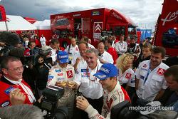 Champagne celebration for Daniel Elena, Guy Fréquelin, Sébastien Loeb and Citroën Sport team members