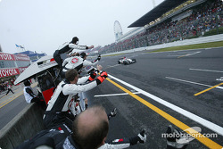 Jenson Button crosses finish line