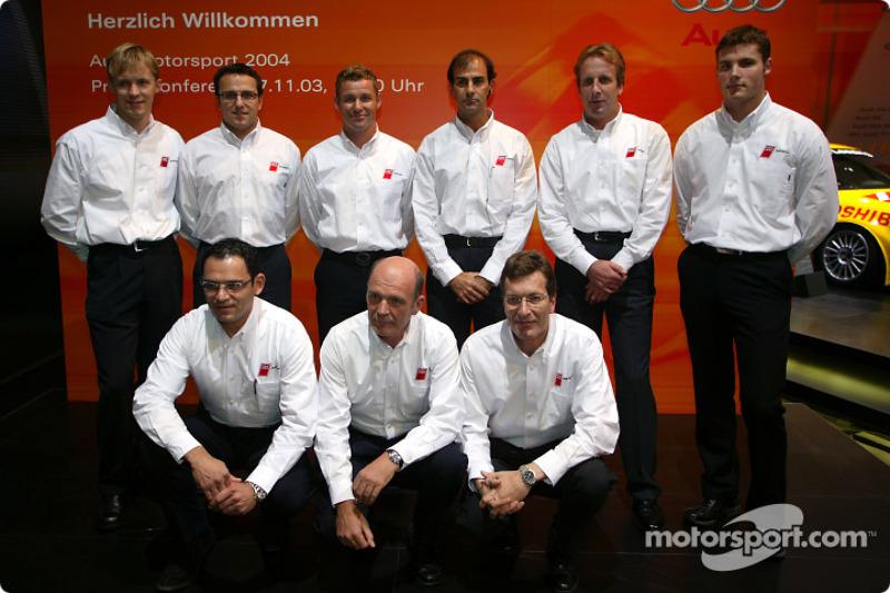 The Audi team for 2004 (from left to right): Mattias Ekström;Christian Abt;Tom Kristensen;Emanuele Pirro;Frank Biela;Martin Tomczyk (standing);Rinaldo Capello;Hans-Jürgen Abt;Head of Audi Sport Dr Wolfgang Ullrich;Ralf Jüttner;Marco Werner;Pierre Kaffe
