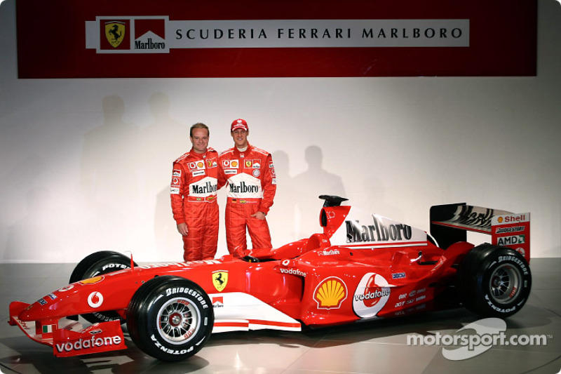 Rubens Barrichello and Michael Schumacher with the new Ferrari F2004