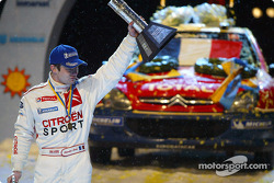 Podium: winner Sébastien Loeb celebrates
