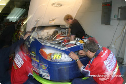Roush Racing garage area: the National Guard crew still work on engine change on Greg Biffle's car