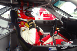 Danny Sullivan buckles into his Ferrari before heading out on the track