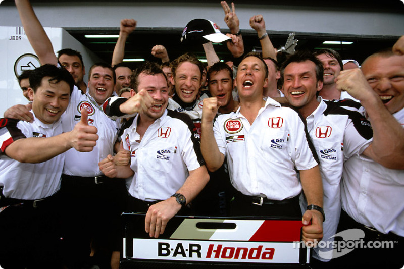 Jenson Button celebrates with his team