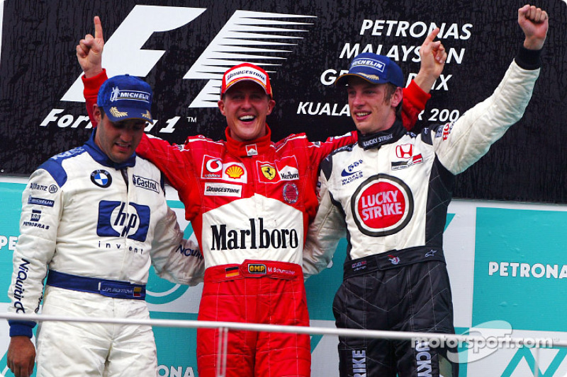 Podium: race winner Michael Schumacher with Juan Pablo Montoya and Jenson Button