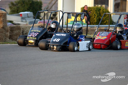 Briggs Junior Champ Lite #48-double winner Matthew Ferris fights off challenges from #26-Geoffery reimer and the 02 of second place finisher Steven Daniels