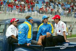 Drivers parade: Cristiano da Matta, Olivier Panis, Jarno Trulli and Fernando Alonso