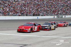 Bill Eliott leads the pack for pit stops