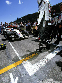Jenson Button pulls up to his pole position slot on the starting grid
