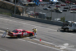 Bill Elliott's old NASCAR seems to need a tow back to the pits