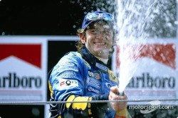Podium: champagne for Jarno Trulli