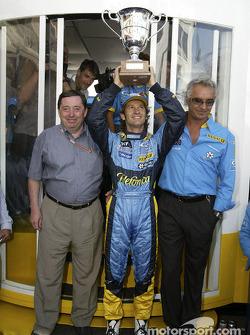 Jarno Trulli celebrates victory with Patrick Faure and Flavio Briatore