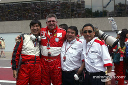 Ross Brawn and Bridgestone team members celebrate victory