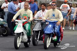 Tony Kanaan, Michael Andretti, Marko Andretti and Dario Franchitti head back to the garage