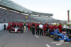 Scott Dixon and Greg Ray's crews during pre-race ceremonies