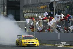 Race winner Tom Kristensen celebrates