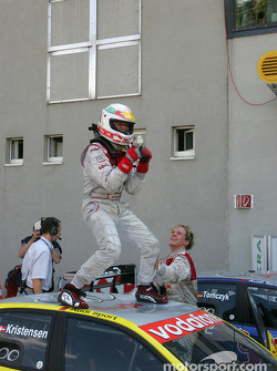 Race winner Tom Kristensen celebrates