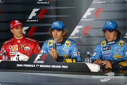 Press conference: pole winner Jarno Trulli with Michael Schumacher and Fernando Alonso