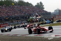 First corner: Rubens Barrichello leads the field