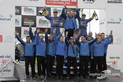Podium: rally winners Petter Solberg and Phil Mills celebrate with the Subaru World Rally Team
