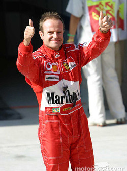 Rubens Barrichello celebrates pole