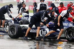 Ralf Schumacher and Juan Pablo Montoya back in the pit