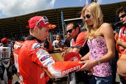 Third place Casey Stoner, Ducati Marlboro Team with wife Adriana