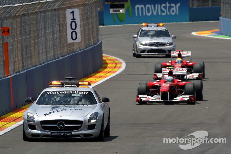 The medical and safety car are sent out after the crash of Mark Webber, Red Bull Racing, as they pass Fernando Alonso, Scuderia Ferrari
