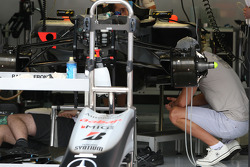 Michael Schumacher, Mercedes GP takes a look at his car